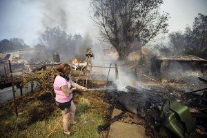 wild_fires San Diego Calif 5-17-2014_lady ffights flames